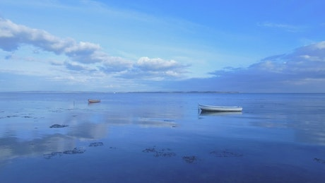 Two boats on a calm ocean