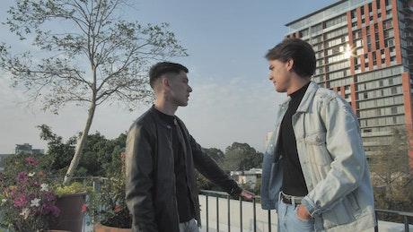 Two boyfriends talking