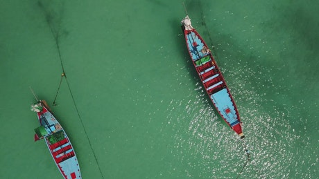 Two canoes in the sea near the shore