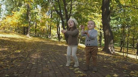 Two children enjoying Autumn