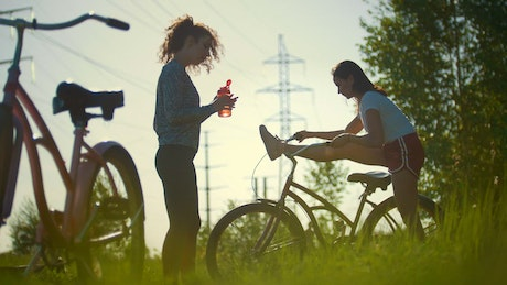 Two cyclist resting in nature