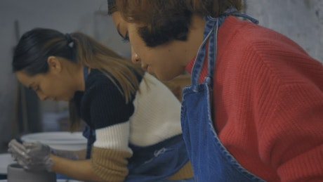 Two excited girls during a pottery class