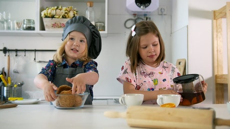 Two girls after successfully baking cookies