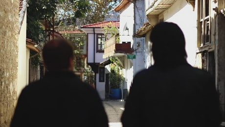 Two men walking along the old alleys