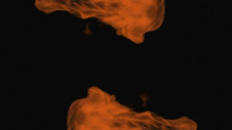 Two orange flames on black background