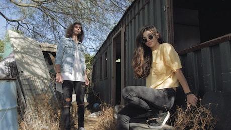 Two people at junkyard
