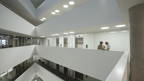Two people talking inside a building