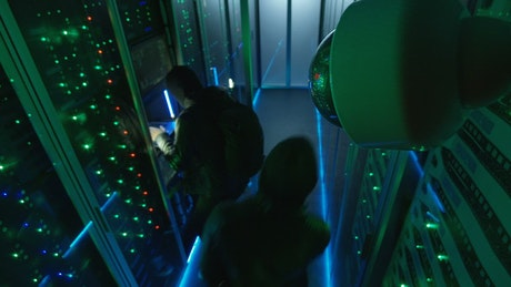Two thiefs hacking a data center