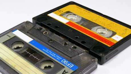 Two vintage audio cassettes rotating