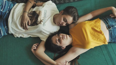 Two women laying together