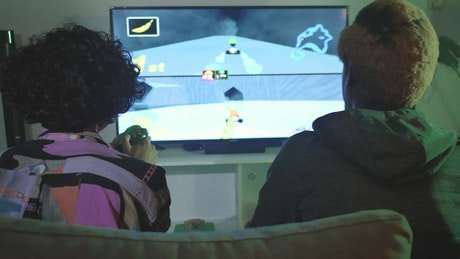 Two young people playing video games