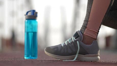 Tying sneakers before running