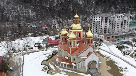 Ukrainian church with golden domes in the winter
