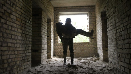 Unconscious soldier carried out