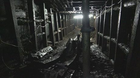 Underground dark tunnel with a light on