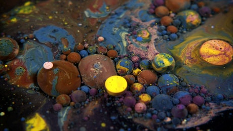 Underwater paint spheres shaped like planets