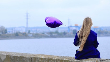 Unhappy child with a balloon