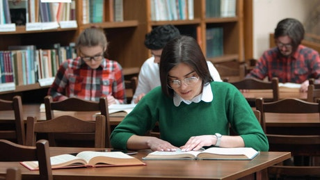 University students study quietly in library