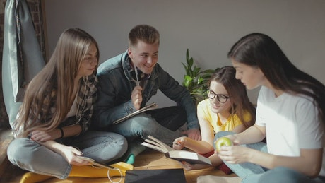University students study together on floor