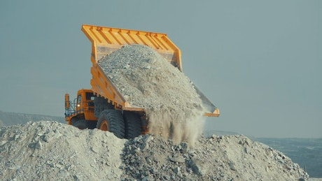 Unloading material from a mine
