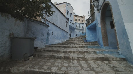 Up the steps of an ancient alley painted blue