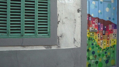 Urban art on the doors of the houses