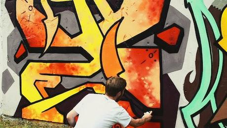 Urban artist painting a graffiti