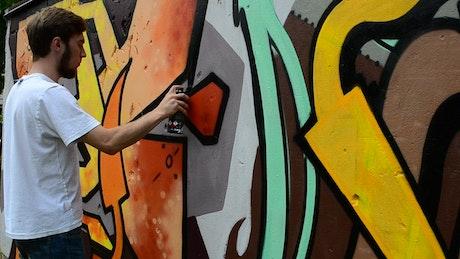 Urban artist spraying a mural
