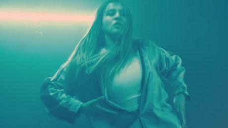 Urban dancer under dim blue lights