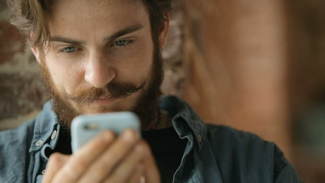 Urban man browses web on mobile phone