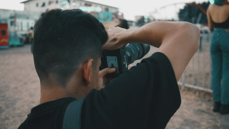 Urban photographer working at the fair