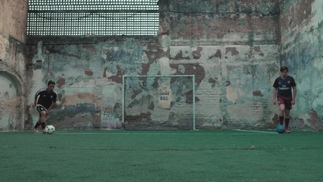 Urban soccer players dribbling the ball