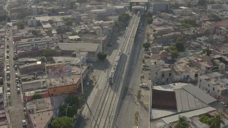 Urban subway, aerial tilt down