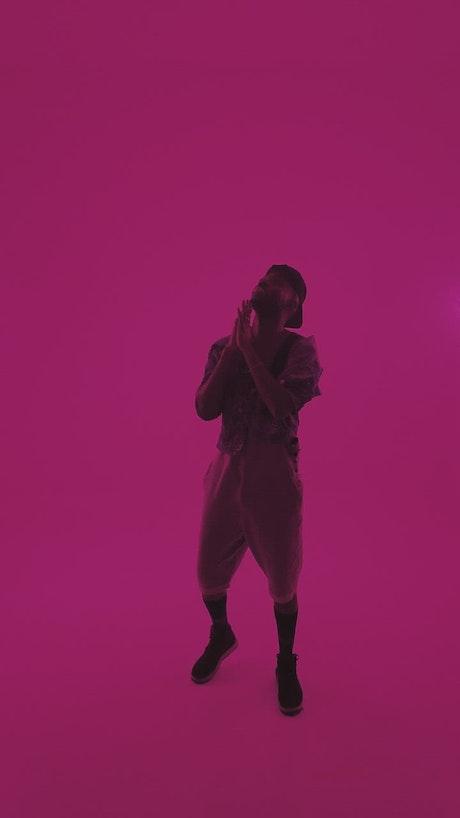 Urban trendy man posing with pink filter