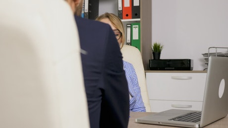 Urban woman interviewing businessman in office