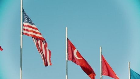 US and Turkey flags blowing in the wind