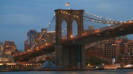 USA Flag above the Brooklyn Bridge