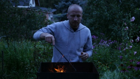 Using a fire poker outside