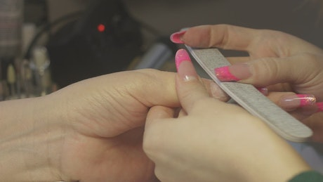 Using a nail file on a client