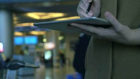 Using a tablet at an airport