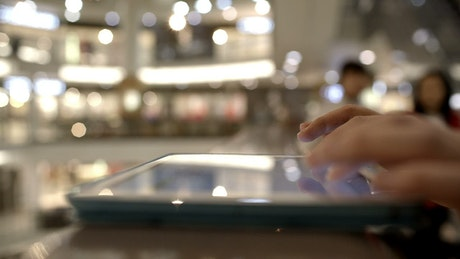 Using a tablet in a Mall