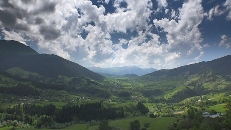 Valley in the mountains with a cloudy sky