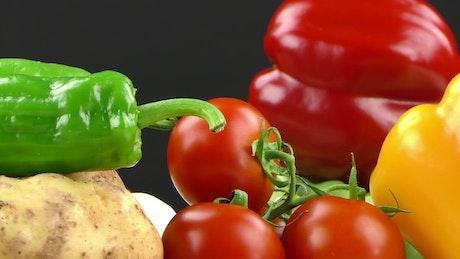 Vegetables on black background, spinning close up