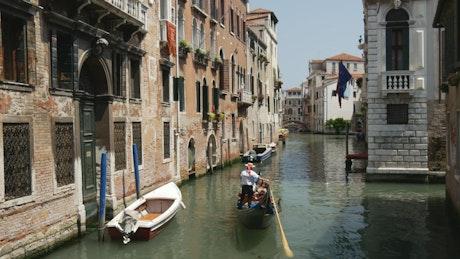 Venice canal with flag