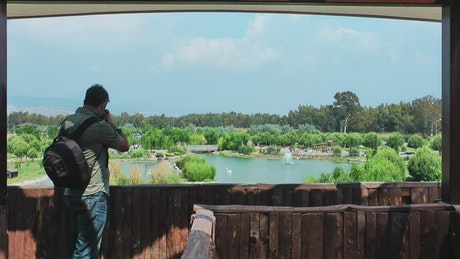 Videographer panning out of a lake