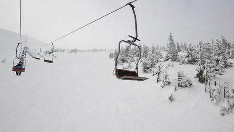 View from a ski lift on snowy mountain