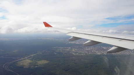View from the airplane of a city in the forest