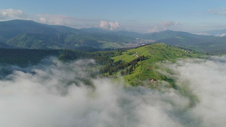 View of a valley seen from the clouds