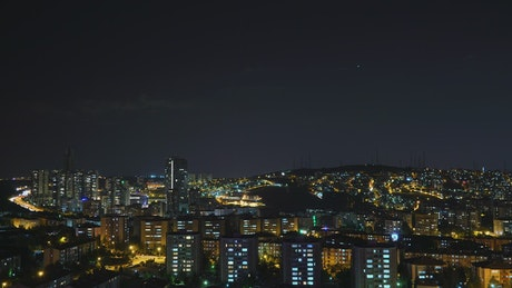 View of the city lights glowing in the night