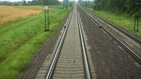 View of  the rail tracks from the train
